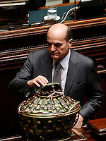 Il deputato Pierluigi Bersani depone la scheda nell'urna durante la seduta comune di deputati e senatori per l'elezione del nuovo Presidente della Repubblica, alla Camera dei Deputati, Roma, 30 gennaio 2015.<br /> Italian deputy Pierluigi Bersani casts his ballot during a joint plenary session of senators and deputies to vote for the election of the new President, at the Lower Chamber, Rome, 30 January 2015.<br /> UPDATE IMAGES PRESS/Riccardo De Luca