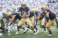 Annapolis, MD - September 8, 2018: Navy Midshipmen quarterback Malcolm Perry (10) hands the ball to Navy Midshipmen fullback Anthony Gargiulo (38) during the game between Memphis and Navy at  Navy-Marine Corps Memorial Stadium in Annapolis, MD.   (Photo by Elliott Brown/Media Images International)