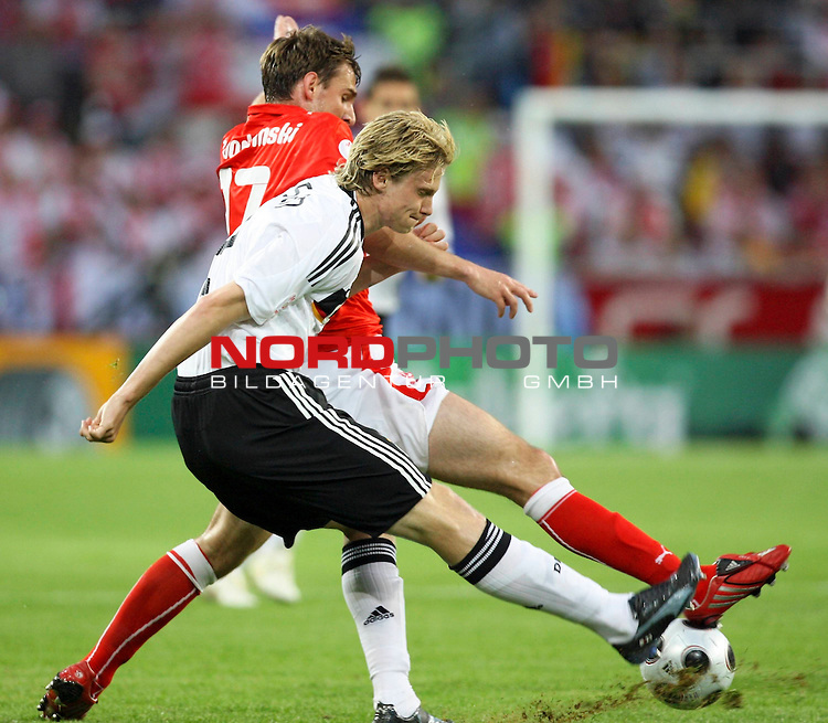 UEFA Euro 2008 Group B Klagenfurt - W&ouml;rthersee Match 04. <br /> Marcell Jansen ( Germany / Verteidiger / Defender / Bayern Muenchen #02 ) (vorne) im Kampf um den Ball mit Wojciech Lobodzinski ( Poland / Mittelfeldspieler / Midfielder / Wisla Krakow #17 ) (hinten).<br /> Foto &copy; nph (  nordphoto  )