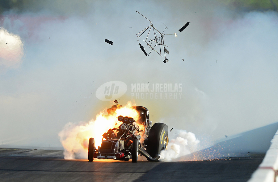 Sept 8, 2012; Clermont, IN, USA: NHRA funny car driver Todd Lesenko blows the body off his car after an explosion and fire during qualifying for the US Nationals at Lucas Oil Raceway. Lesenko would be uninjured. Mandatory Credit: Mark J. Rebilas-