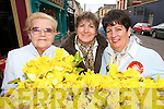 GREAT BUNCH: Nora Canty  (Listowel), Helen O'Connor (The Six Crosses) and Eiloeen Fennell  (Ballylongford)  were some of the volunteers on the streets of Listowel raising funds for cancer during Daffodil Day on Friday last.