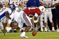 Oshiomogho Atogwe causes a fumble during Stanford's 63-26 win over San Jose State on September 14, 2002 at Stanford Stadium.<br />Photo credit mandatory: Gonzalesphoto.com