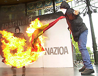 Hooded people burn a Spanish flag after a demonstration with the slogan &quot;No Apartheid, self determination&quot; in Donostia - San Sebastian. Sunday August 9, 2.003. 'NO APARTHEID' MANIFESTAZIOA DONOSTIAN. 2003-08-19.<br /> Photo-Argazkia: Ander Gillenea