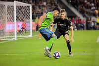 LOS ANGELES, CA - OCTOBER 29: Cristian Roldan #7 of the Seattle Sounders FC dances with the ball past Walker Zimmerman #25 of Los Angeles FC during a game between Seattle Sounders FC and Los Angeles FC at Banc of California Stadium on October 29, 2019 in Los Angeles, California.