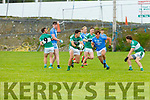 Listry Jimmy O'Leary claims the loose ball ahead of Sean Burke Firies  during their JFC clash in Kilcummin on Sunday