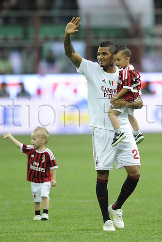 14 05 2011  Series A Milan Cagliari  Photo Kevin Prince Boateng with his kids salutes the crowd . AC Milan drew 0-0 with Cagliari but won the Serie A tile for the 18th time.