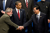 Pittsburgh, PA - September 25, 2009 -- Luiz Inacio Lula da Silva, president of Brazil, left, greets Hu Jintao, president of China, right, as U.S. President Barack Obama looks on before a Group of 20 nations family photo on day two of the G-20 summit in Pittsburgh, Pennsylvania, U.S., on Friday, September 25, 2009. G-20 leaders are working on an accord to prevent a repeat of the worst global financial crisis since the Great Depression and ensure a sustained recovery. .Credit: Andrew Harrer / Pool via CNP