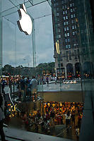 "People visit the Mac store in New York, July 15, 2012. New York CIty recently unveiled plans to turn outdated public payphone infrastructure into free WiFi hotspots, according to Mashable. New Yorkers and visitors alike will be able to connect to ""NYC-PUBLIC-WIFI"" using smartphones, tablets, or laptops. local media reported. Photo by Eduardo Munoz Alvarez / VIEW."