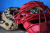 Batavia Muckdogs catchers mask and glove during a game vs. the Auburn Doubledays at Dwyer Stadium in Batavia, New York September 3, 2010.   Batavia defeated Auburn 8-5.  Photo By Mike Janes/Four Seam Images