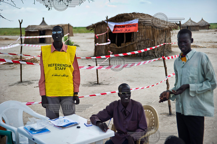 Officials outside a Referendum Centre on the road between Bentiu and Nyal. In January 2011 South Sudan will vote to decide its independence.