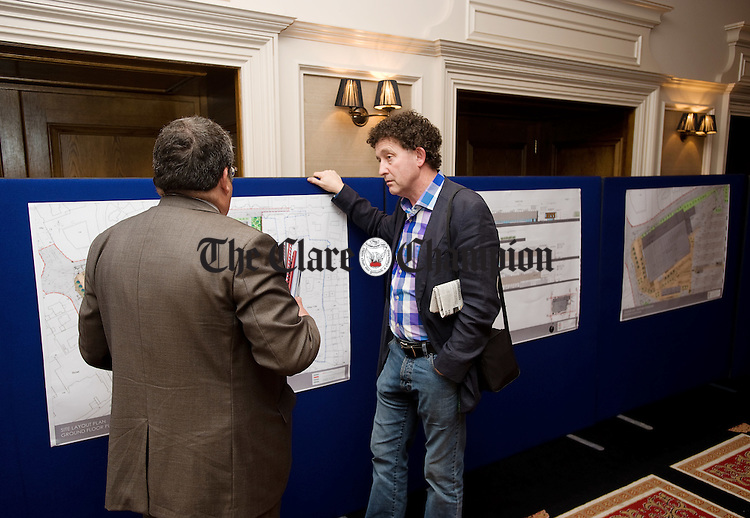 Terry Morgan, Traffic Engineer chatting with Ennis Town Councillor Johnny Flynn during an open exhibit of the proposed plans for a District Centre on the Michael Lynch site at the Clare Road, Ennis. Photograph by John Kelly.