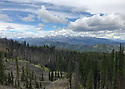 Scenery at Blewett Pass, WA featuring mountain range, forest, snow, sky and clouds in the Wenatchee Mountains. Stock photography by Olympic Photo Group