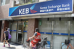 July 23, 2010 - Tokyo, Japan - A Korea Exchange Bank (KEB) branch is pictured near JR Shin-okubo station in Tokyo, Japan, on July 23, 2010. Japanese fans of South Korean actor and singer Park Yong-ha, who commits suicide on June 30th, visited a memorial altar set up at a Korean restaurant in Tokyo's Okubo district, where many Koreans live.