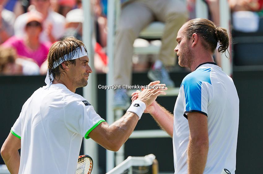 18-06-13, Netherlands, Rosmalen,  Autotron, Tennis, Topshelf Open 2013, , Xavier Malisse  defeats  Ferrer and gets the handshake <br /> Photo: Henk Koster
