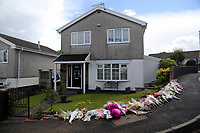 COPY BY TOM BEDFORD<br /> Pictured: Flowers left at the scene where Pearl Black was hit by a car in Heolgerrig, Merthyr Tydfil, Wales, UK. Friday 18 August 2017<br /> Re: The funeral of a toddler who died after a parked Range Rover's brakes failed and it hit a garden wall which fell on top of her will be held today at Merthyr Tydfil.<br /> One year old Pearl Melody Black and her eight-month-old brother were taken to hospital after the incident in south Wales.<br /> Pearl's family, father Paul who is The Voice contestant and mum Gemma have said she was &quot;as bright as the stars&quot;.