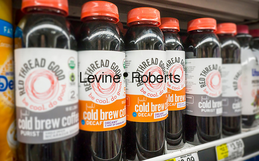 Bottles of Read Thread Good brand organic ready-to-drink coffee in a supermarket in New York on Wednesday, May 25, 2016. Coffee makers are throwing their weight into canned and bottled coffee, both cold brew and traditional in hopes that consumers will pick up on the fad. Ready-to-drink coffee sales in the U.S. have grown in the double digits in the last five years. (© Richard B. Levine)