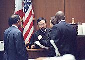 Superior Court Judge Lance Ito, center, listens to prosecutor Marcia Clark, center right, during a bench conference in the middle of the trial of former NFL star running back O.J. Simpson for the murder of his former wife, Nicole Brown Simpson and a friend of hers, restaurant waiter, Ron Goldman in Los Angeles County Superior Court in Los Angeles, California on July 13, 1995.  From left to right: Defense Attorney Robert Shapiro, Judge Ito, Clark, and prosecutor Christopher Darden.<br /> Credit: Steve Grayson / Pool via CNP