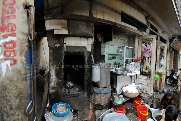 Asia, Vietnam, Hanoi. Hanoi old quarter. Open air kitchen belonging to a roadside restaurant.