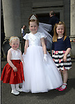 Lucy Clinton with her sisters Abbey and Aislinn after making her First Communion at the Lourdes Church on Saturday. www.newsfile.ie