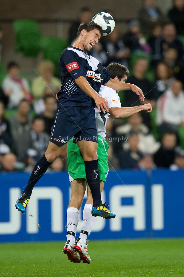 MELBOURNE, AUSTRALIA - May 14, 2010: Rodrigo Vargas from Melbourne Victory heads the ball at the Kevin Muscat Testimonial match between the Melbourne Victory and Come Play XI at AAMI Park on May 14, 2010 in Melbourne, Australia. Photo Sydney Low www.syd-low.com