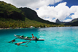 FRENCH POLYNESIA, Moorea Island. A family spearfishing at Opunohu Bay.