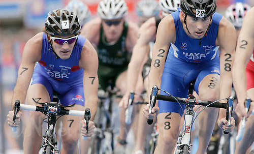 02 SEP 2007 - HAMBURG, GER - Stuart Hayes (GBR) on right leads Tim Don (GBR) through transition - Elite Mens World Triathlon Championships. (PHOTO (C) NIGEL FARROW)