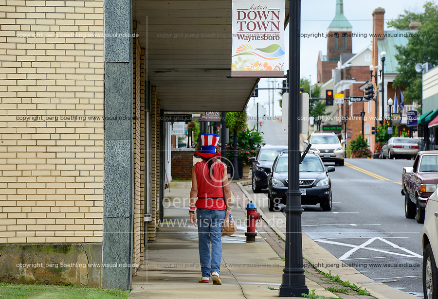 USA, Virginia, Waynesboro, Mr. America walking in downtown
