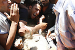 Palestinians cry during they wheel a wounded Islamic Jihad gunman to the Khan Younis hospital in southern Gaza Strip. Israeli strikes in southern Gaza killed three Palestinian gunmen Monday and injured three others, militants said. Three Islamic Jihad men were killed by Israeli fire when they were planting explosives along the Gaza-Israel border, according to Abu Ahmad, a spokesman for the group.