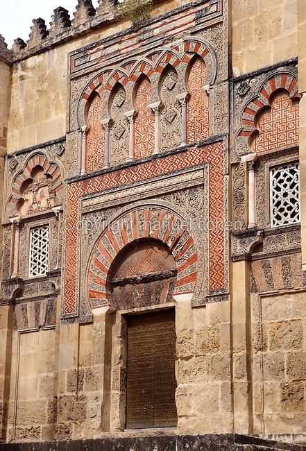 Doorway of al-Hakan II; Circa 961 AD; Western Façade; Great Mosque, Cordoba, Andalusia, Spain; The frieze with interlaced arches supported upon small marble columns, alternates designs of vine leaves and swastikas crosses; The perforated capitals are reminiscent of Byzantine art; They support strong imposts which in turn absorb the downward thrust of the overhanging arches. Picture by Manuel Cohen