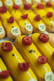 France, Paris, Close up on row of Eclairs with yellow glazing in L'Eclair de Gene