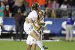 10 November 2013: Florida State's Kristin Grubka (13) and Kassey Kallman celebrate the victory. The Florida State University Seminoles played the Virginia Tech Hokies at WakeMed Stadium in Cary, North Carolina in a 2013 NCAA Division I Women's Soccer match and the championship game of the Atlantic Coast Conference tournament. Florida State won the game 1-0.