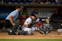 Umpire Brock Ballou and Pensacola Blue Wahoos catcher Ryan Jeffers (8) during a Southern League game against the Mobile BayBears on July 25, 2019 at Blue Wahoos Stadium in Pensacola, Florida.  Pensacola defeated Mobile 3-2 in the second game of a doubleheader.  (Mike Janes/Four Seam Images)