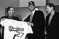 Los Angeles Dodgers General Manager Kevin Malone, new Dodgers pitcher Kevin Brown, and player agent Scott Boras at a press conference announcing Brown's signing with the Los Angeles Dodgers at Dodger Stadium during the 1998 season in Los Angeles, California. (Larry Goren/Four Seam Images)