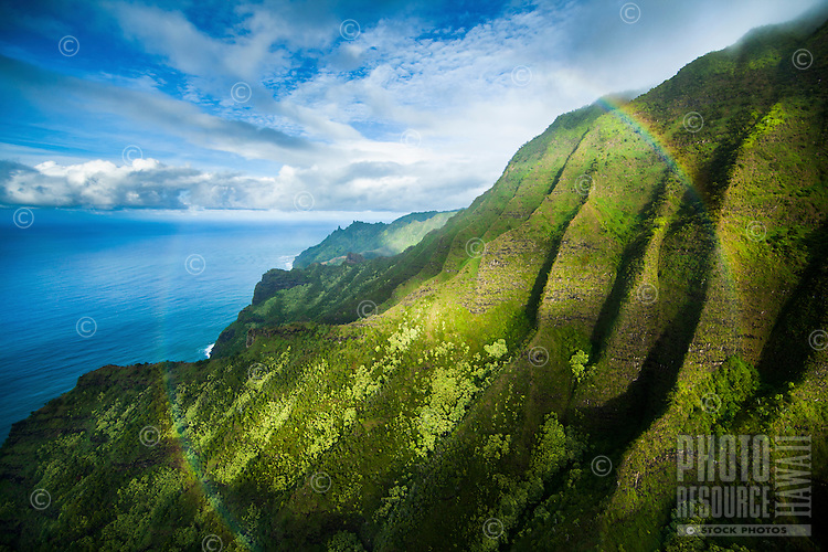 A full rainbow can be seen in this aerial view of Na Pali cliffs on Kaua'i.