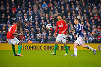 Saturday, 9 March 2013<br /> <br /> Pictured: Roland Lamah of Swansea City Ki Sung-Yueng of Swansea City Graham Dorrans of West Bromwich Albion<br /> <br /> Re: Barclays Premier League West Bromich Albion v Swansea City FC  at the Hawthorns, Birmingham, West Midlands