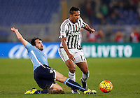 Calcio, Serie A: Lazio vs Juventus. Roma, stadio Olimpico, 4 dicembre 2015.<br /> Juventus&rsquo; Alex Sandro, right, is tackled by Lazio&rsquo;s Marco Parolo during the Italian Serie A football match between Lazio and Juventus at Rome's Olympic stadium, 4 December 2015.<br /> UPDATE IMAGES PRESS/Riccardo De Luca