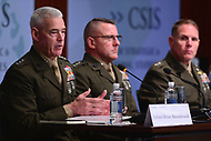 """Washington, DC - June 4, 2018: Lt. General Brian Beaudreault, USMC, Deputy Commandant for Plans, Policies and Operations, speaks during the """"Maritime Security Dialogue"""" panel discussion at the Center for Strategic and International Studies in Washington, D.C. June 4, 2018, as LtGen Robert Hedelund and LtGen Robert Walsh look on.  (Photo by Don Baxter/Media Images International)"""