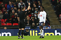 Victor Wanyama of Tottenham Hotspur receives a yellow card the Fly Emirates FA Cup Fourth Round Replay match between Tottenham Hotspur and Newport County at Wembley Stadium, London, England, UK. 07 February 2018