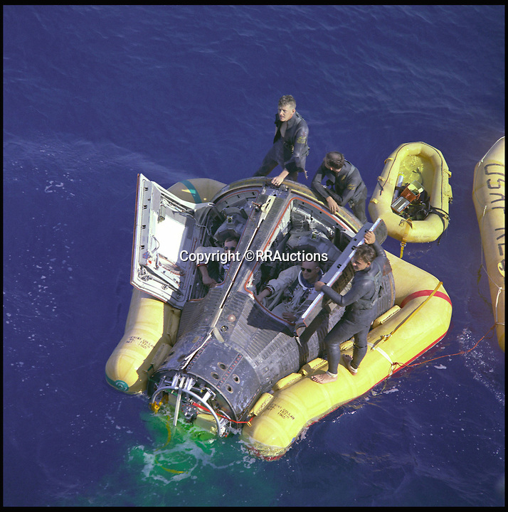 BNPS.co.uk (01202 558833)<br /> Pic: RRAuctions/BNPS<br /> <br /> ***Please Use Full Byline***<br /> <br /> March 16, 1966 Astronauts Neil A. Armstrong and David R. Scott sit with their spacecraft hatches open while awaiting the arrival of the recovery ship, the USS Leonard F. Mason after the successful completion of their Gemini VIII mission.<br /> <br /> Space fans have got the chance to own a piece of history - after one of the capsules from the ground-breaking Gemini space missions of the 1960s emerged for sale.<br /> <br /> The 9ft capsule was used by NASA to test the design and handling of the spacecraft during the highly dangerous missions, which resulted in the first ever space walks.<br /> <br /> The Gemini missions paved the way for putting man on the moon with the Apollo space programme by testing longer space flights and perfecting methods of re-entry and landing.<br /> <br /> Experts at Boston saleroom RR Auction where it will go under the hammer are expecting it to fetch upwards of $50,000 - around &pound;35,000