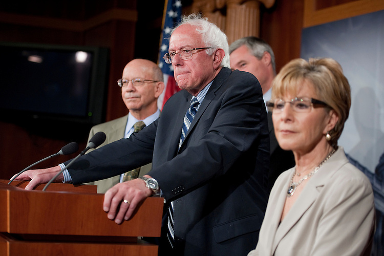 UNITED STATES - SEPTEMBER 14:  From left, Rep. Pete DeFazio, D-Ore., Sens. Bernie Sanders, I-Vt., Sheldon Whithouse, D-R.I., and Barbara Boxer, D-Calif., conduct a news conference in the Capitol to introduce legislation that would support Social Security by raising the payroll tax, which funds the system.  (Photo By Tom Williams/Roll Call)