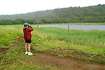 Hawaii: Kauai, birder at National Wildlife Refuge in Hanalei Valley.  Photo hifree137.Photo copyright Lee Foster, 510/549-2202, lee@fostertravel.com, www.fostertravel.com