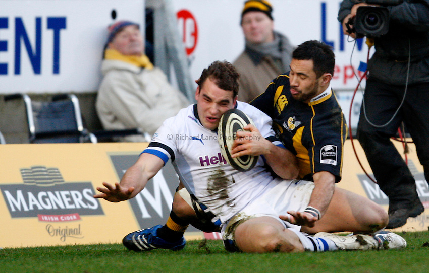 Photo: Richard Lane/Richard Lane Photography..London Wasps v Bath Rugby. Guinness Premiership. 29/12/2007. .Bath's Olly Barkley is tackled into touch by Wasps' Riki Flutey.