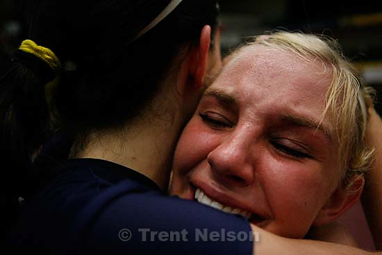 Orem - snow canyon's mykelle webster (right) in tears with teammate liz mcarthur after coming back from 0-2 to win the state championship. Snow Canyon vs. Dixie for the 3A State Championship in girls high school volleyball.&amp;#xA;; 10.28.2006<br />