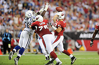 Sept. 27, 2009; Glendale, AZ, USA; Arizona Cardinals quarterback (13) Kurt Warner is pressured by Indianapolis Colts defensive tackle (68) Eric Foster at University of Phoenix Stadium. Mandatory Credit: Mark J. Rebilas-