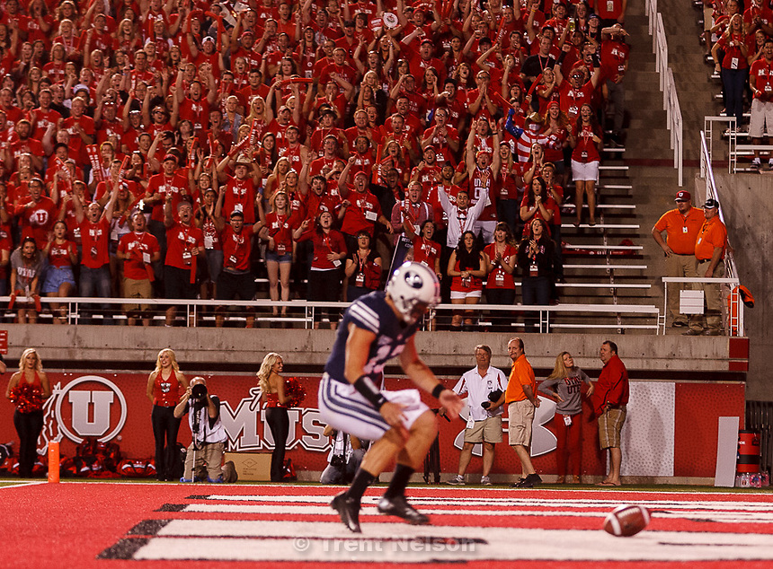 Trent Nelson  |  The Salt Lake Tribune.Utah fans in the MUSS cheer as Brigham Young quarterback Riley Nelson (13) fumbles the snap into the end zone as Utah hosts BYU college football in Salt Lake City, Utah, Saturday, September 15, 2012.