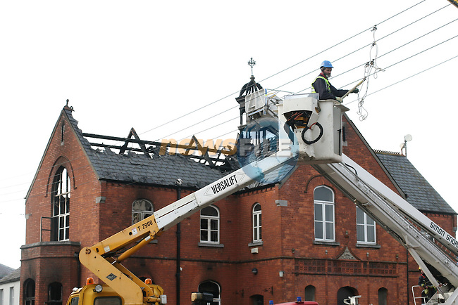 Drogheda Fire Fighters begin to remove the bell tower of Drogheda Housing and Planning Section which was destroyed by fire last night.  A technical exaimination will take place to determine the cause of the fire...Photo NEWSFILE/Jenny Matthews.(Photo credit should read Jenny Matthews/NEWSFILE)....This Picture has been sent you under the condtions enclosed by:.Newsfile Ltd..The Studio,.Millmount Abbey,.Drogheda,.Co Meath..Ireland..Tel: +353(0)41-9871240.Fax: +353(0)41-9871260.GSM: +353(0)86-2500958.email: pictures@newsfile.ie.www.newsfile.ie.FTP: 193.120.102.198.