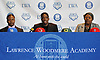 Lawrence Woodmere Academy's Aidan Igiehon, a 6'10 basketball standout from Ireland, speaks at a news conference at the school alongside his uncle, Solomon Edore, and aunt, Zenobia Edore, shortly prior to selecting the University of Louisville as his college choice on Friday, Oct. 19, 2018.