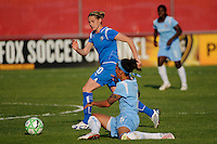 Kelly Smith (10) of the Boston Breakers gets past a fallen Natasha Kai (6) of Sky Blue FC. Sky Blue FC defeated the Boston Breakers 2-1 during a Women's Professional Soccer match at Yurcak Field in Piscataway, NJ, on May 31, 2009.