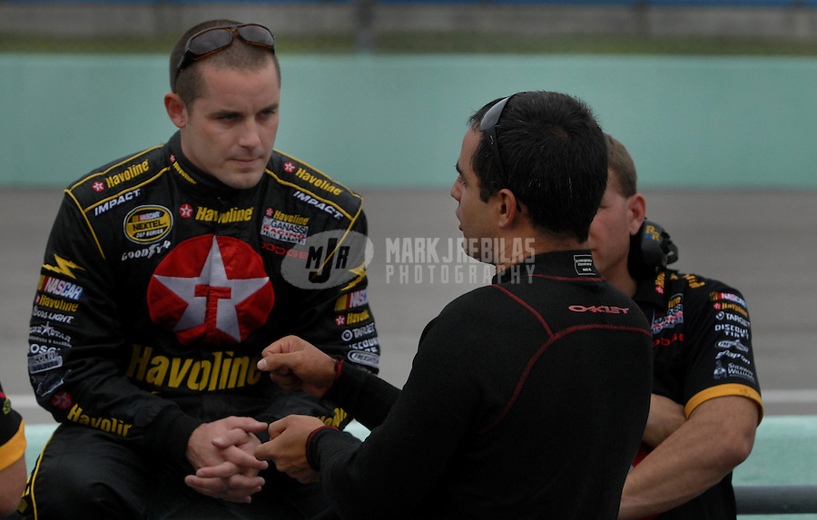 Nov. 19, 2006; Homestead, FL, USA; Nascar Nextel Cup driver Casey Mears (42) talks with Juan Pablo Montoya (30) during the Ford 400 at Homestead Miami Speedway. Mandatory Credit: Mark J. Rebilas