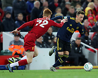 30th October 2019; Anfield, Liverpool, Merseyside, England; English Football League Cup, Carabao Cup, Liverpool versus Arsenal; Mesut Ozil of Arsenal takes on Sepp van den Berg of Liverpool - Strictly Editorial Use Only. No use with unauthorized audio, video, data, fixture lists, club/league logos or 'live' services. Online in-match use limited to 120 images, no video emulation. No use in betting, games or single club/league/player publications